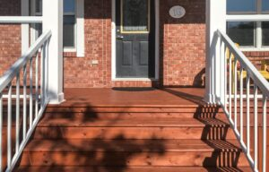 front of house red deck stain exterior painting job
