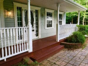 front of house red deck with white fences